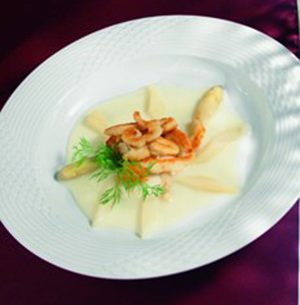Plate with Asparagus soup with pangasius strips